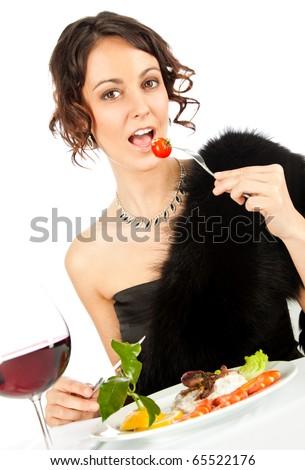 stock photo beautiful elegant female sitting in restaurant eating salad 65522176