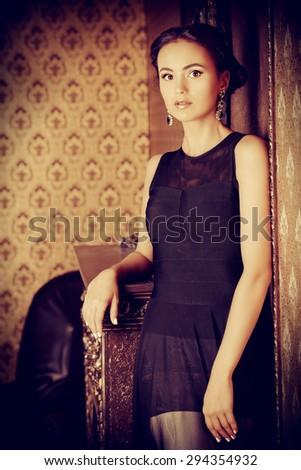 Beautiful elegant lady in vintage interior. Fashion shot. - stock photo
