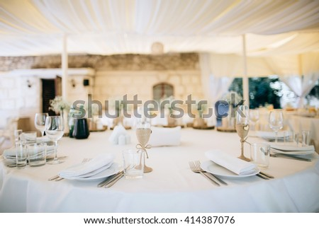 Beautiful elegant, luxury wedding reception restaurant venue with stylish white marble floor and tables - stock photo