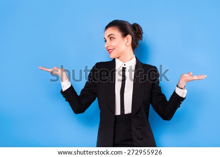 beautiful elegant office woman showing sign on blue background - stock photo