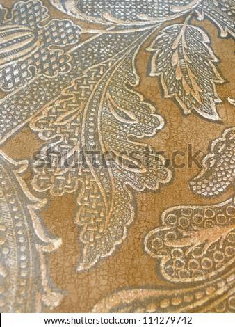 Beautiful, elegant paisley in deep autumn colors, red, orange, sepia, brown. - stock photo