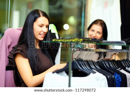 beautiful elegant woman shopping in clothes store