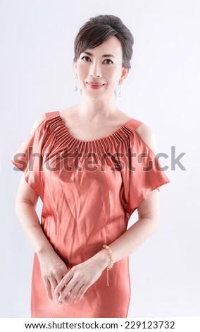 Beautiful elegant woman wearing lace dress - stock photo
