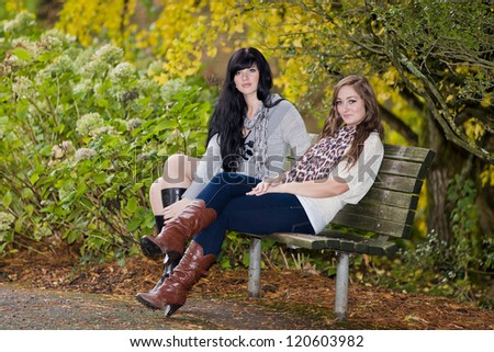 Beautiful elegant young women and autumn colors.