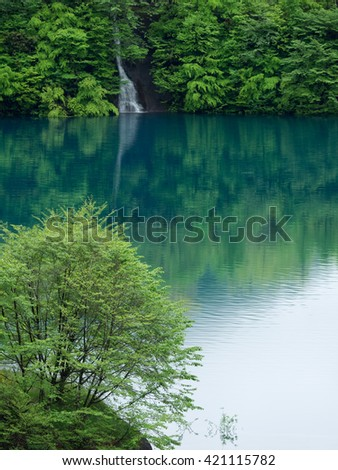 Beautiful emerald green lake_Okushima Lake in japan - stock photo