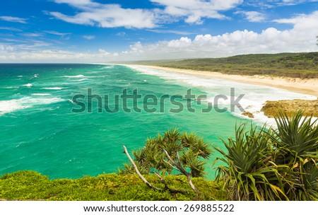 Beautiful endless Australian beach on Stradbroke Island, Queensland - stock photo