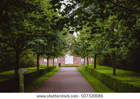 Beautiful entryway of trees near house facade