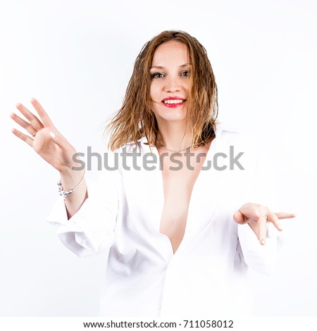 beautiful erotic girl with wet red hair and the Bob haircut in white shirt with beautiful jewelry in the Studio on a white background with red lips