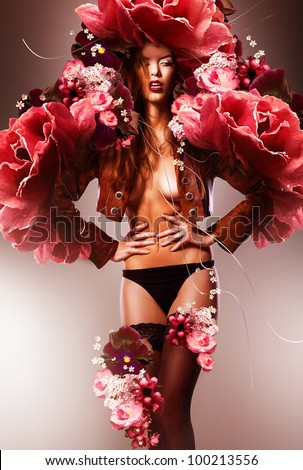 beautiful erotic sexy flower woman in jacket and flowers - stock photo