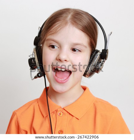 Beautiful european little girl singing - stock photo
