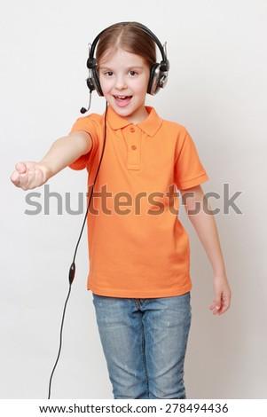 Beautiful european little girl singing - stock photo