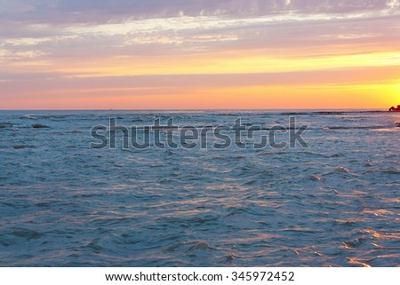 Beautiful evening sea against the cloudy sky - stock photo
