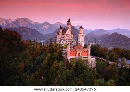 Beautiful evening view of the Neuschwanstein castle, with autumn colours after sunset, Bavarian Alps, Bavaria, Germany - stock photo