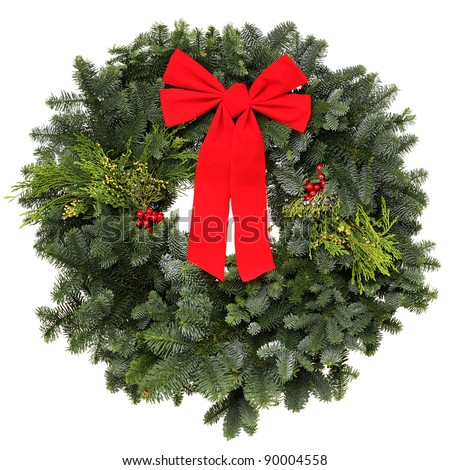 Beautiful evergreen Christmas wreath with red bow, isolated - stock photo