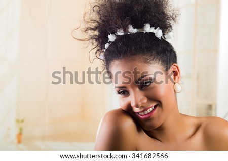 Beautiful exotic young girl wearing a floral hairband. Closeup portrait - stock photo