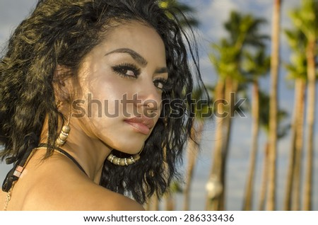 Beautiful exotic young woman in tropical location - stock photo