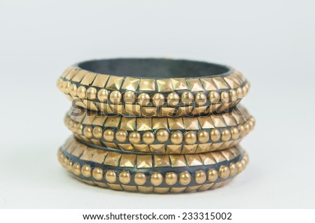 Beautiful expensive gold bracelets on white background - stock photo