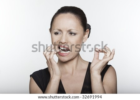 beautiful expressing woman portrait on isolated background toothache - stock photo