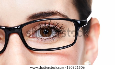 Beautiful eye with glasses close up. Isolated on white background. - stock photo