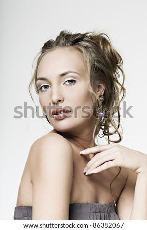 beautiful face girl with perfect skin wearing jewelry - stock photo