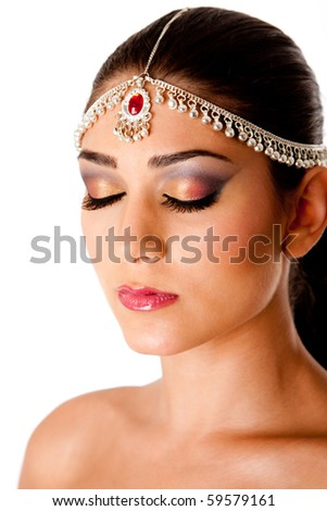 Beautiful face of a Middle Eastern woman with Arabic style makeup and head jewelry, typically used by Indian belly dancers, isolated. - stock photo