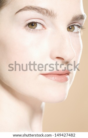 Beautiful face of a young adult woman with clean fresh skin