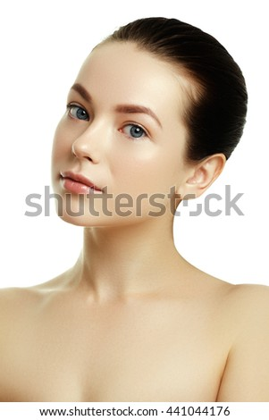 Beautiful face of a young caucasian woman. Woman beauty face portrait with healthy skin. Portrait of beautiful young woman looking at camera. Natural beauty concept - stock photo