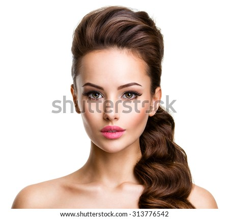 Beautiful face of an young sexy woman with long hairs posing at studio on white background - stock photo