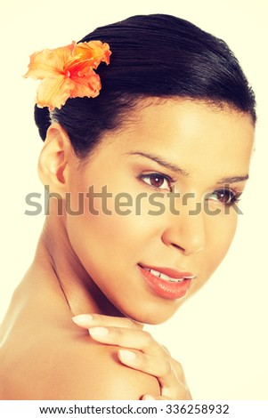 Beautiful face of exotic woman with healthy clean skin.