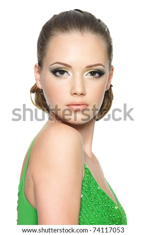 Beautiful face of the teenager girl with bright fashion make-up - on white background