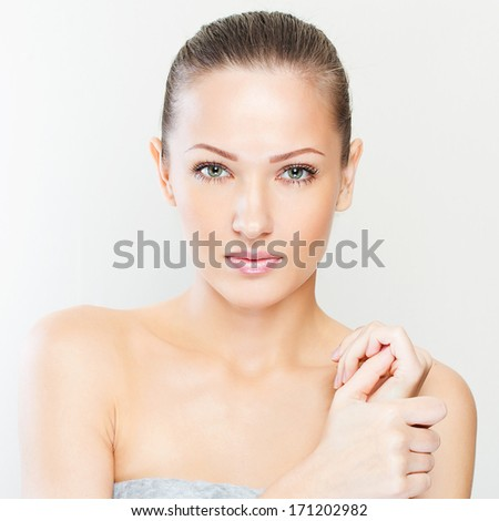 Beautiful face of young adult woman with clean fresh skin - stock photo