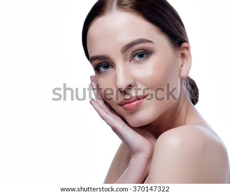 Beautiful face of young adult woman with clean fresh skin - isolated on white.