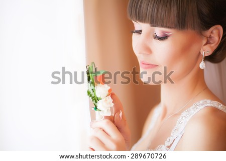 Beautiful Face of Young Blond Bride Woman. Beauty Morning Portrait.Girl Look in Window.Bridal Veil. Curtains - stock photo