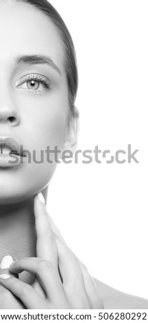 Beautiful face of young caucasian girl with natural make-up, perfect skin and green eyes isolated on white background. Studio portrait. Black and white