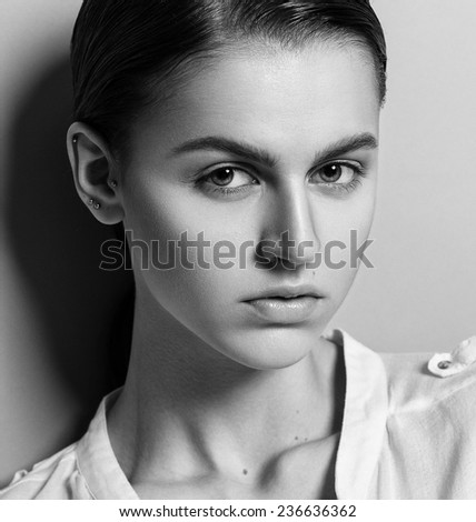 Beautiful face of young model with clean fresh skin and natural make-up. Androgyne young woman. Black and White photo - stock photo