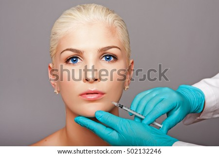 Beautiful face of young woman for Aesthetics facial skincare concept anti-wrinkle  injection by cosmetic plastic surgeon beautician.