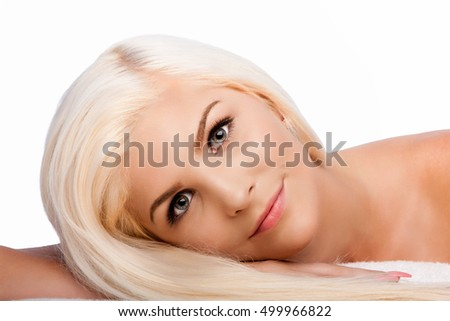 Beautiful face of young woman for Aesthetics facial skincare concept laying on side, on white.