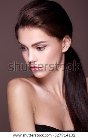 Beautiful Face of Young Woman with Clean Fresh Skin  Beauty Portrait. Perfect Fresh Skin. Pure Beauty Model. Youth and Skin Care Concept - stock photo