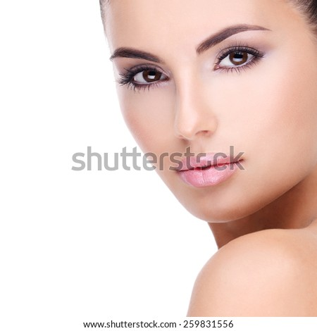Beautiful face of young woman with clean fresh skin - isolated on white - stock photo