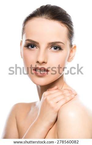 Beautiful face of young woman with clean fresh skin  isolated on white background.