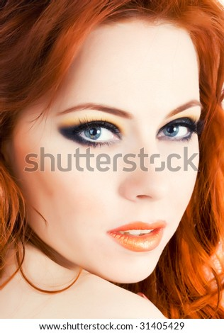 Beautiful face of young woman with red hair - stock photo