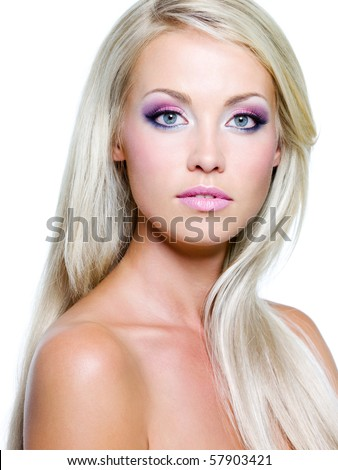 Beautiful face with brightly colors of make-up and straight long hair - stock photo