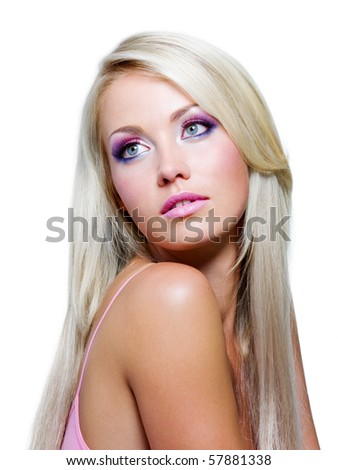 Beautiful face with saturated colors of make-up and straight long hair - stock photo