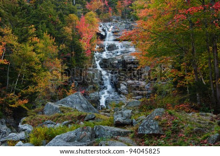 Beautiful fall foliage at the Silver Cascade. Crawford Notch State Park, White Mountains, New Hampshire - stock photo