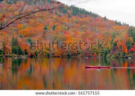 Beautiful fall landscape with  lake and mountains