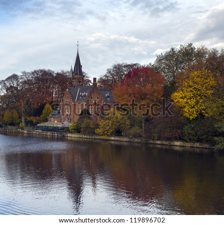 "Beautiful Fall View of Medieval Buildings on Canal in""Rozenhoedkaai "" Bruges, Belgium - stock photo"