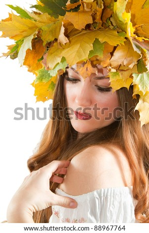 Beautiful fall woman. close up portrait of girl with  autumn wreath of maple leaves shouts  touting white teeth on  isolated white background.