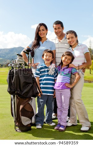 Beautiful family at the golf field looking happy - stock photo
