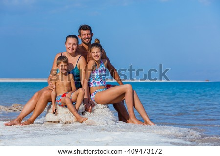 Beautiful family at the spa Dead Sea. Israel