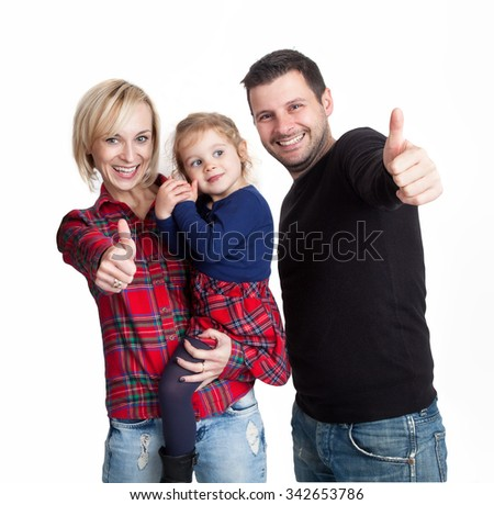 Beautiful family is showing the thumb up - stock photo